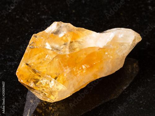 Foto Murales raw crystal of Citrine gemstone on black
