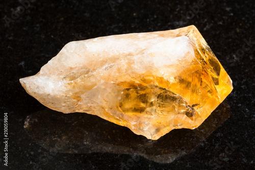 Foto Murales rough crystal of Citrine gemstone on black