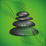 schwarze gestapelte zen steine und grüne palmenblätter - 210066099