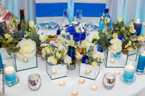Foto Murales Wedding table arrangement with flower and candle