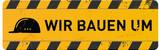 gelbes Schild Wir bauenn um mit Helm-Icon - 210075276