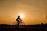 Silhouette of cycling on sunset background. - 210089435