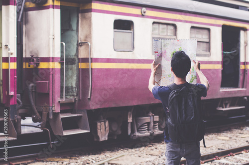 Fototapeta Asian man Traveler Backpack in main train station City Concept