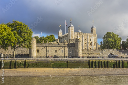 View of the Tower of London from the Thames river. London England