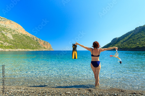 Foto Murales Woman with flippers snorkeling tube on beach