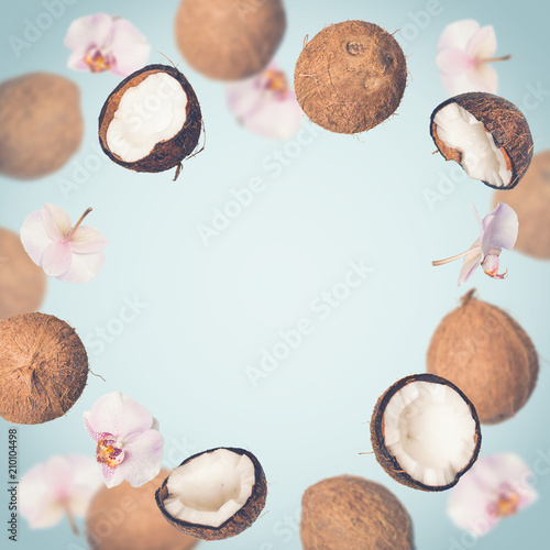 Blue tropical summer background with falling coconuts