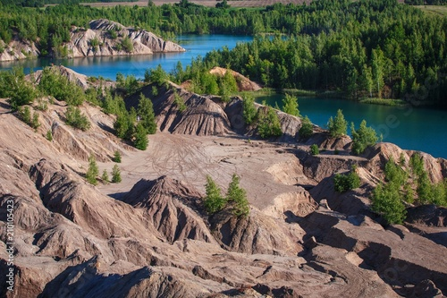 Foto Murales a lake among the mountains with a Martian relief