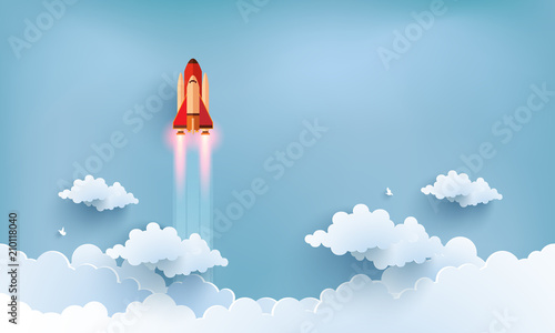 Fototapeta illustration of the shuttle. flying across beautiful clouds at full speed. paper art design