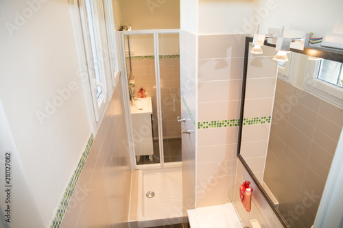 a small white bathroom with shower