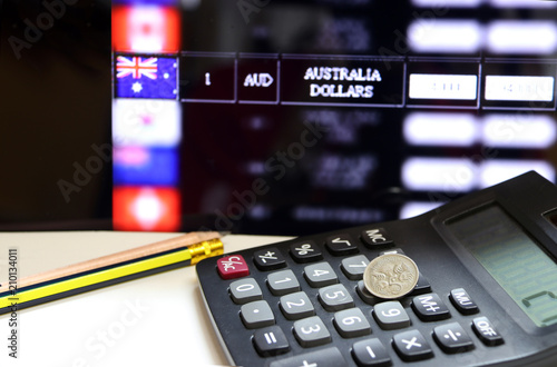 Five Cents Coin Of Australia On The Calculator With Pencils On The White Floor And Digital