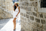 Fashion model posing in street of rustic town - 210139229