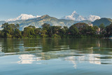 The Machapuchare and Annapurna range seen from Phewa Lake in Pokhara, Nepal  - 210139240