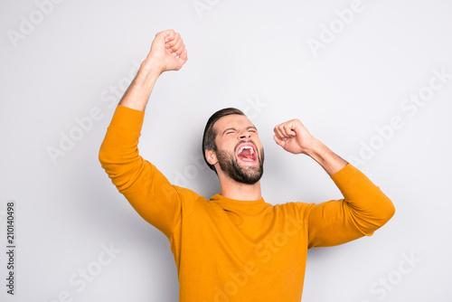 Leinwanddruck Bild People leadership wonderment concept. Portrait of cheerful excited joyful careless handsome attractive delightful yelling shouting guy isolated on gray background