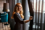 Glamorous woman  staring through window - 210143817