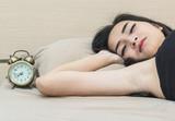 Asian women sleep on bed in bedroom - 210146230