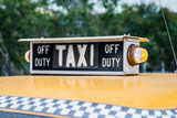 old retro taxi on the streets waiting for customers - 210151471
