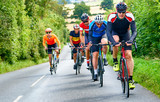 Cyclists racing on country roads on a sunny day in the UK. - 210151670