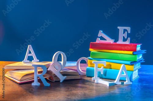 Alphabet. Education. books in color covers. training. letters fall out of books. books for training. - 210168061