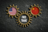Gears on slate background with the flags of USA and China in it, connected bei a gear with the words