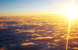View of clouds at sunset from plane window - 210172887