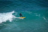 Aerial view of a surfer on a wave - 210186438