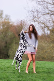 young woman plays with Dalmatian dog outdoors - 210190038