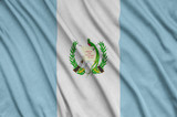 Guatemala flag  is depicted on a sports cloth fabric with many folds. Sport team banner