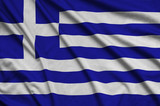 Greece flag  is depicted on a sports cloth fabric with many folds. Sport team banner - 210200620