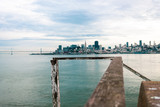 San Francisco Skyline from Alcatraz with weathered wooden handrail