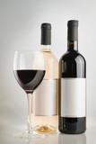 Red and white wine bottles with wine glass - 210223605