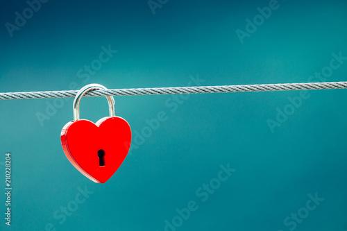 Red love lock padlock on bridge outdoor - 210228204
