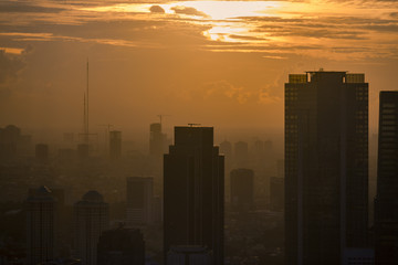 The Sun Sets Through the Air Pollution On A Hot Summer Day In Jakarta Indonesia © Brendt-Petersen