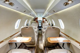 Cabin of executive jet with tables open - 210267237