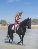 riding girl on the beach - 210271873