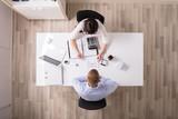 Two Businesspeople Analyzing Bill