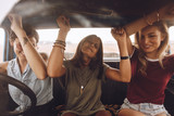 Friends enjoying traveling in the car - 210275054