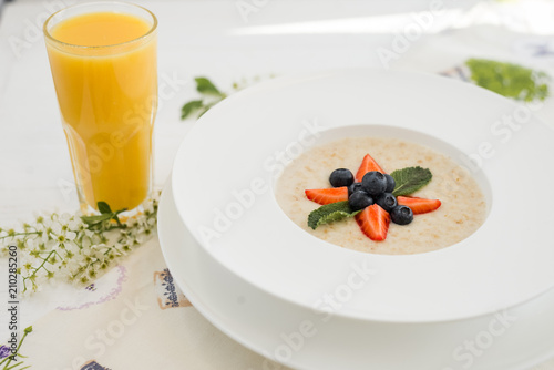 Oatmeal with berries and orange juice	 - 210285260