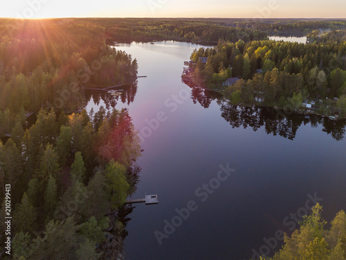 Fotobehang Zomer Aerial view of the sunset over the lake and forest