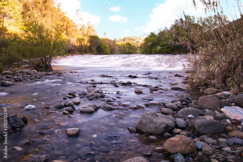 Fotobehang Lavendel River silky smooth water long exposure shot