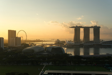 Singapore cityscape at dusk. Landscape of Singapore business building around Marina bay. Modern high building in business district area at twilight..