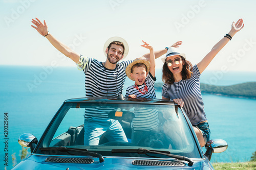 Happy family travel by car to the sea. People having fun in cabriolet. Summer vacation concept - 210325664