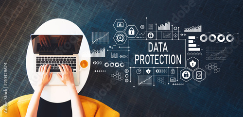 Data protection with person using a laptop on a white table