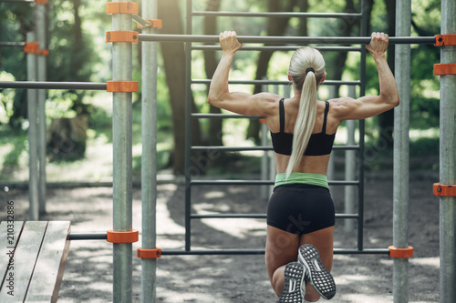Fotobehang Fitness Fitness Woman Doing Training Workout Outdoor in Summer Morning Park. Concept Sport Healthy Lifestyle.