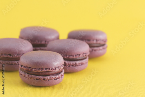 Fotobehang Macarons Purple French Macarons on a Yellow Background