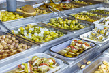 Various kinds of Olives at street Market in Spain. - 210352044