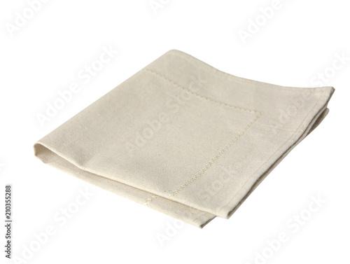 Kuchenny beżowy ręcznik składający odizolowywającym na bielu.