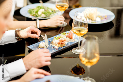 Close-up view on the delicious meals and wine during a business lunch at the restaurant - 210359076