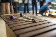 xylophone and drumsticks in a music class with children