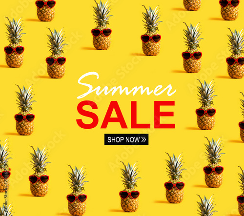 Summer sale with series of pineapples wearing sunglasses on a yellow background - 210382254