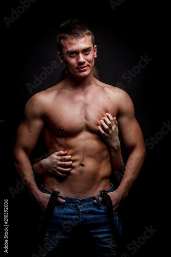 Shirtless man and female hands - 210392036